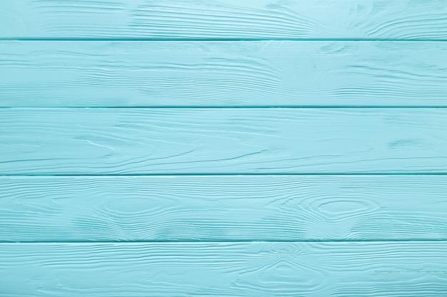 Hellblaue plankenbeschaffenheit des holztischs. pastellfarbener hintergrund.
