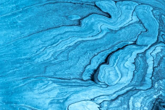 Hellblaue und schwarze farben des abstrakten flüssigen kunsthintergrundes. flüssiger marmor. acrylbild auf leinwand mit türkisfarbenem farbverlauf. aquarellhintergrund mit wellenförmigem muster des himmels. stein abschnitt.