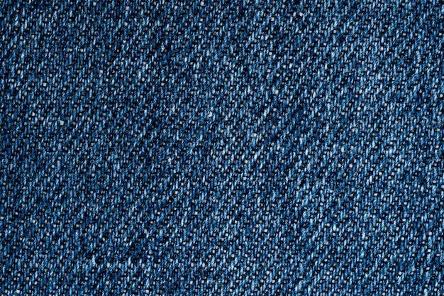Hellblauer denimbeschaffenheitsabschluß herauf oberflächenhintergrund