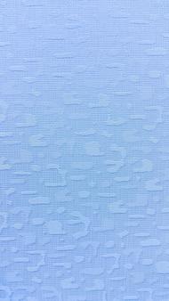 Hellblauer gewebebeschaffenheitshintergrund