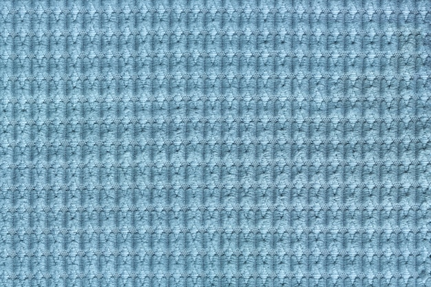 Hellblauer hintergrund vom weichen flauschigen gewebeabschluß oben. textur von textilien makro