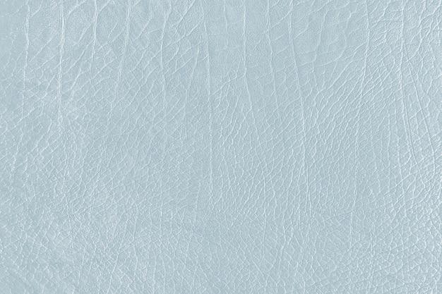 Hellblauer strukturierter hintergrund aus zerknittertem leder