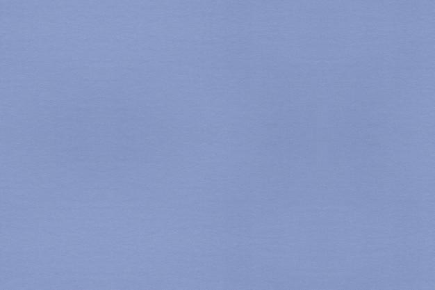 Hellblauer strukturierter hintergrund des papiers. reinigen sie strukturierten hintergrund