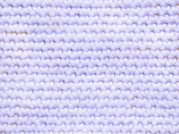 Hellblaues farbiges gestricktes trikot als textiler hintergrund