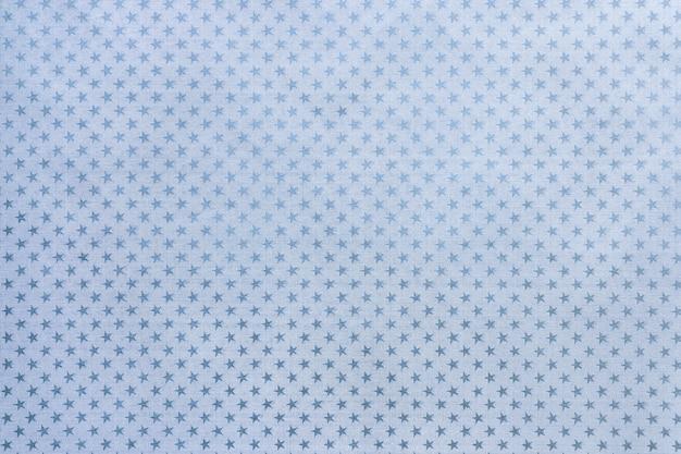 Hellblaues metallfolienpapier mit einem sternchenmuster