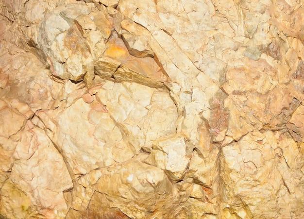 Hellbraune steinfelsenbeschaffenheit und -hintergrund.