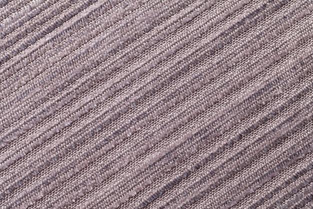 Hellbrauner hintergrund eines gestrickten textilmaterials