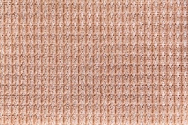 Hellbrauner hintergrund vom weichen flaumigen gewebeabschluß oben, beschaffenheit von geweben