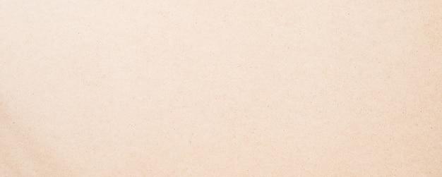 Hellbrauner oder beigefarbener kraftpapier- oder kartonbeschaffenheitshintergrund