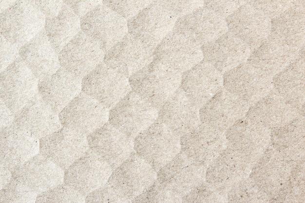 Hellbrauner papierstrukturhintergrund oder kartonoberfläche aus einer pappschachtel zum verpacken