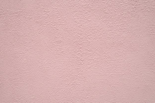 Helle beige und pfirsich feine textur des putzes. hintergrund.