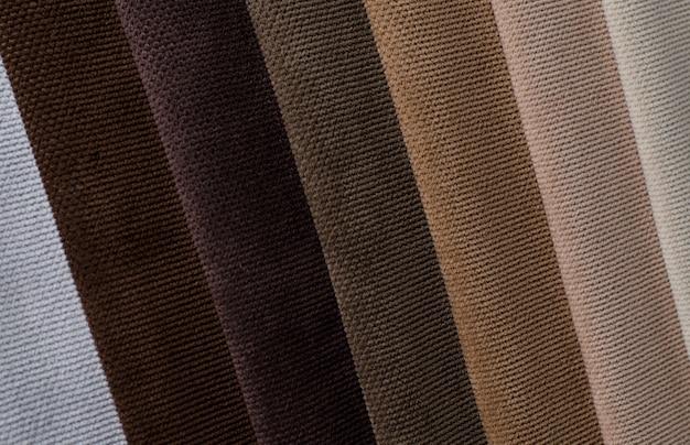 Helle farbvelour-textilproben. gewebebeschaffenheitshintergrund