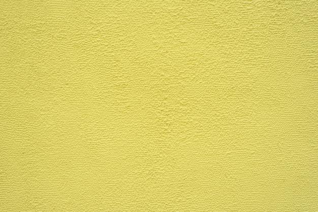 Helle gelbe feine beschaffenheit des gipses. hintergrund.