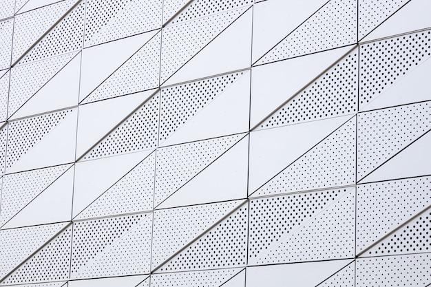 Helle oberfläche mit geometrischem muster mit runden öffnungen