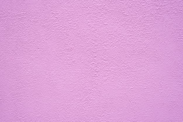 Helle rosa feine beschaffenheit des gipses. hintergrund.