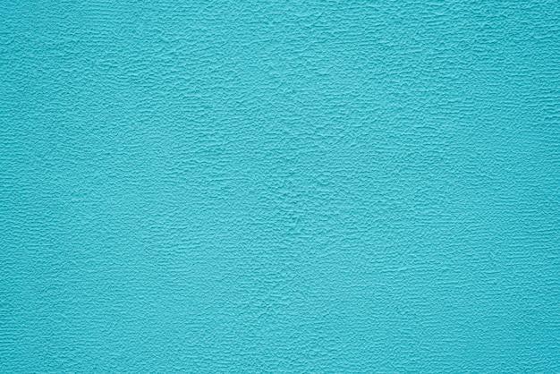 Helle türkisfarbene feinstruktur aus gips. hintergrund.