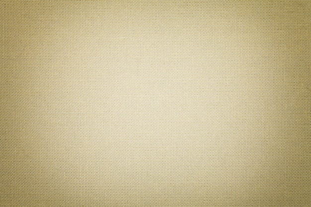 Heller beige hintergrund von einem textilmaterial. stoff mit natürlicher textur. hintergrund.