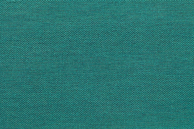 Heller cyan-blauer hintergrund von einem textilmaterial mit weidenmuster, nahaufnahme.