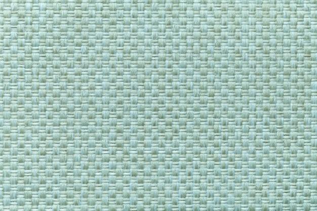 Heller cyan-blauer textilhintergrund mit kariertem muster, nahaufnahme. struktur des gewebemakros.