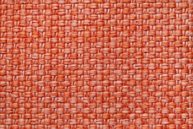 Heller orange textilhintergrund mit kariertem, struktur des gewebemakros,