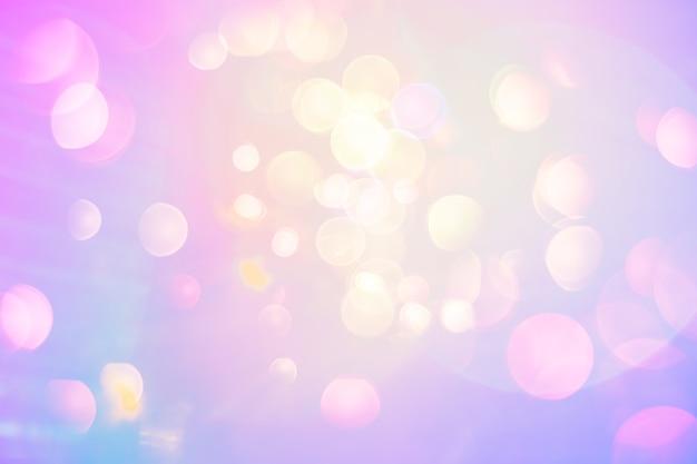Heller perliger fantasiehintergrund. lens flare bokeh in neonfarben auf einem sonnigen himmel. lustige sommer- oder frühlingsbeschaffenheit