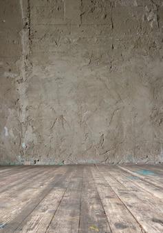 Heller weinlesestudioinnenraum mit bretterboden und roher betonmauer