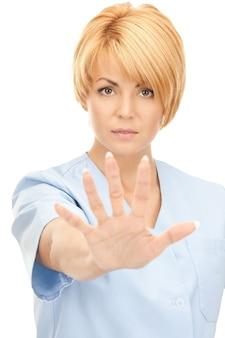 Helles bild einer attraktiven ärztin mit stoppgeste