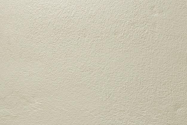 Hellgelbe farbe alte grunge-wand-beton-textur als hintergrund.