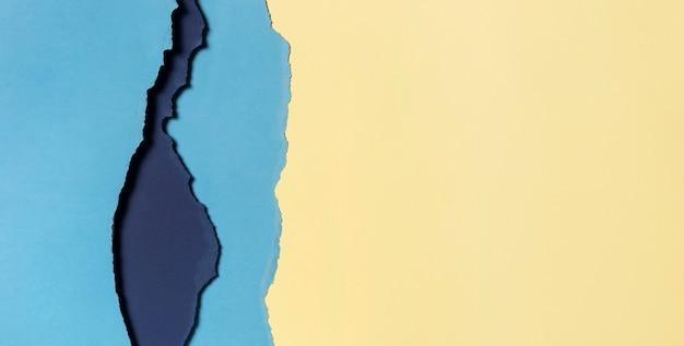 Hellgelbe und blaue schichten papierkopierfläche