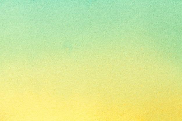 Hellgelbe und grüne farben des hintergrundes der abstrakten kunst. aquarell auf leinwand, farbverlauf.