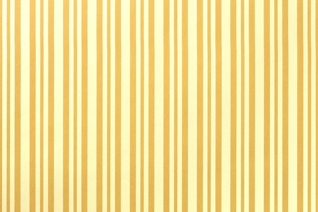 Hellgelber und goldener hintergrund aus gestreiftem geschenkpapier,