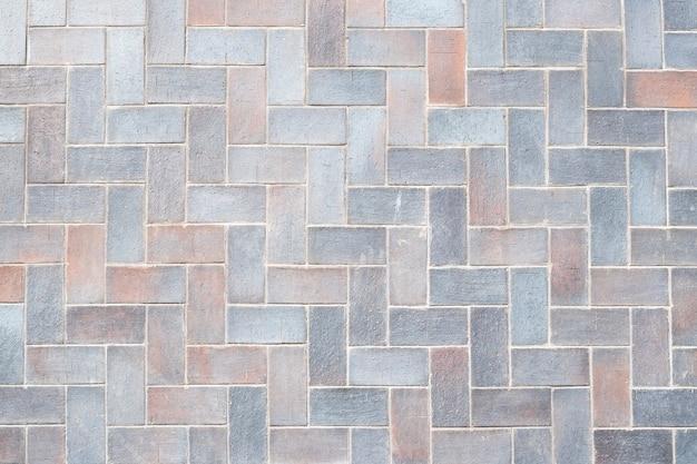 Hellgraue fliesenbeschaffenheit, steinmauerhintergrund. ziegelmuster, bodenfläche. geometrisches innenelement. abstrakte grunge-tapete.