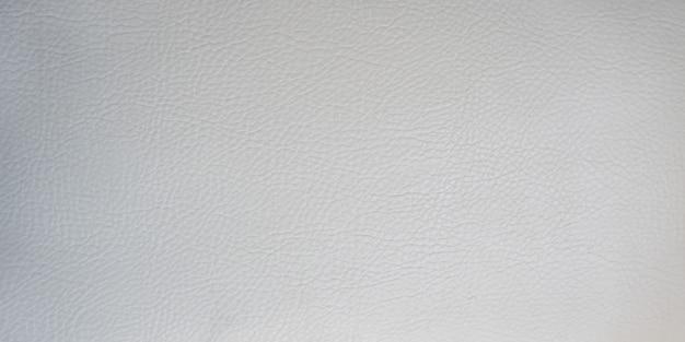 Hellgraue glatte lederoberfläche. wände und texturen