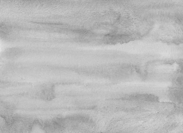 Hellgraue hintergrundbeschaffenheit des aquarells. grauer abstrakter hintergrund. monochrome flecken auf papier.