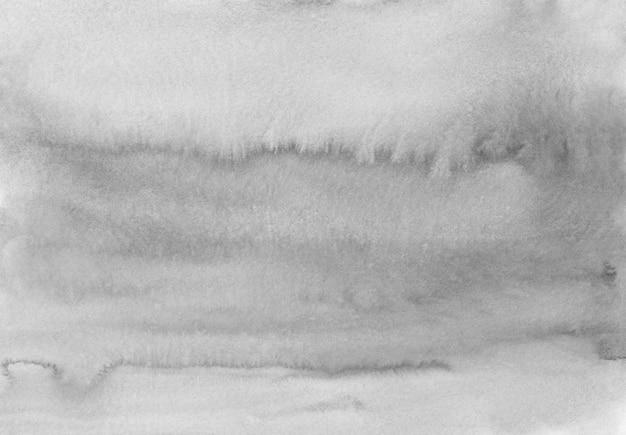 Hellgraue hintergrundbeschaffenheit des aquarells. monochrome flecken auf papierauflage. abstrakte aquarellschwarzweissmalerei.
