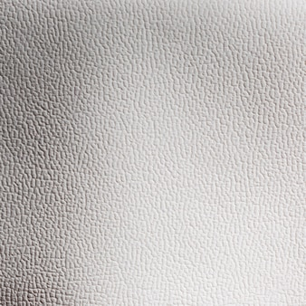 Hellgraue ledertextur-hintergrundoberfläche der extrem nahen nahaufnahme