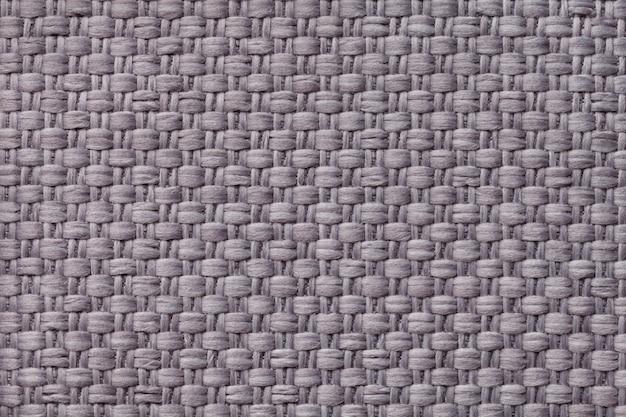 Hellgrauer textilhintergrund mit kariertem