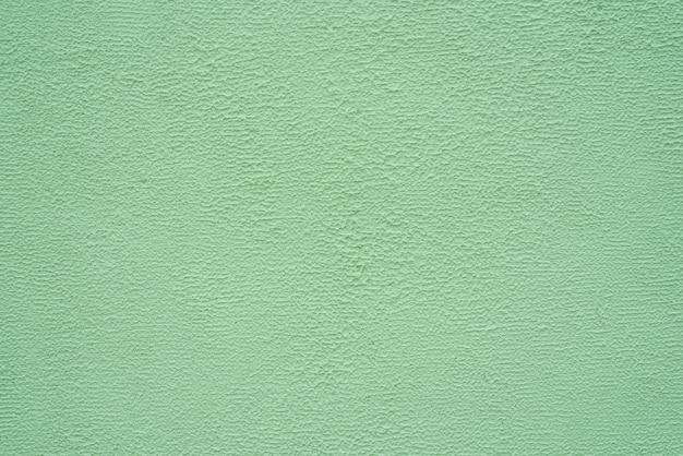 Hellgrüne feine textur des putzes. hintergrund.