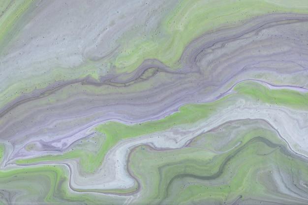 Hellgrüne und graue farben des abstrakten flüssigen kunsthintergrundes. flüssiger marmor. acrylmalerei mit olivgrünem farbverlauf und spritzer. aquarellhintergrund mit wellenförmigem muster. stein marmorierter abschnitt.