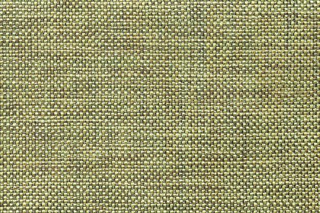Hellgrüner textilhintergrund mit kariertem muster, nahaufnahme. struktur des gewebemakros.