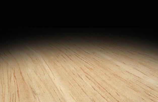 Hellholzboden der perspektive verblassen zu schwarzem hintergrund, schablone verspotten für anzeige des produktes