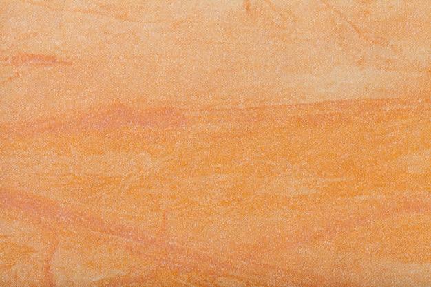 Hellorange farbe des hintergrundes der abstrakten kunst. mehrfarbenmalerei auf segeltuch.