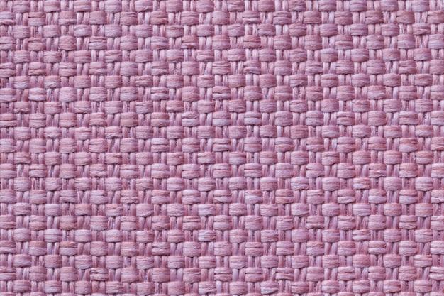 Hellpurpurner textilhintergrund mit kariertem muster, nahaufnahme. struktur des gewebemakros.