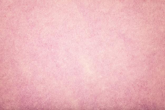 Hellrosa matter veloursleder-gewebehintergrund. velvet textur aus filz.
