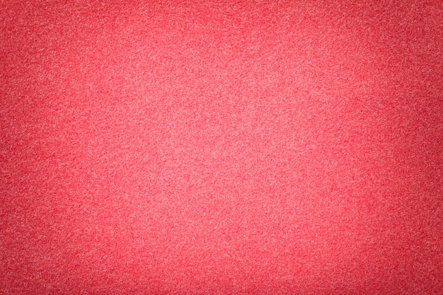 Hellrote matte veloursledergewebenahaufnahme. velvet textur aus filz.