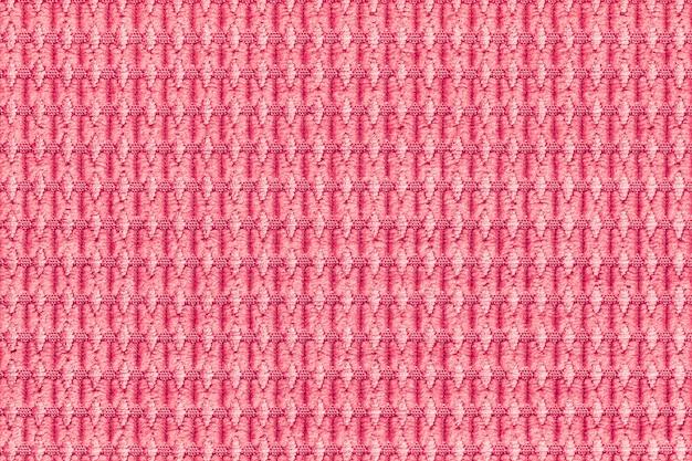 Hellroter hintergrund von der weichen flaumigen gewebenahaufnahme. textur von textilien makro.
