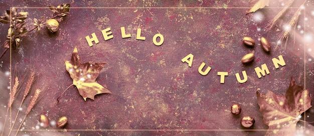 Herbst flach lag mit bemalten goldenen blättern und text