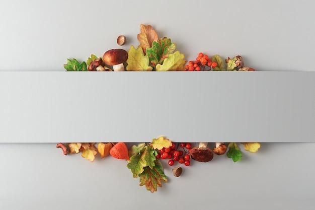 Herbstzusammensetzung von blättern, pilzen und beeren auf grauem hintergrund mit kopienraum. ansicht von oben.