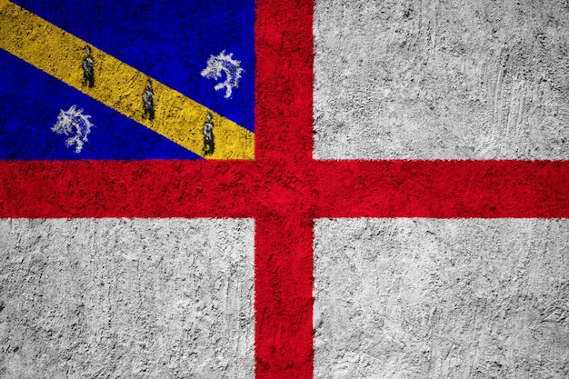 Herm-flagge gemalt auf schmutzwand