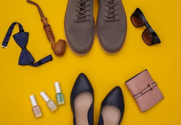 Herren- und damenschuhe und accessoires auf gelbem hintergrund. ansicht von oben